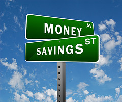 money and savings street signs